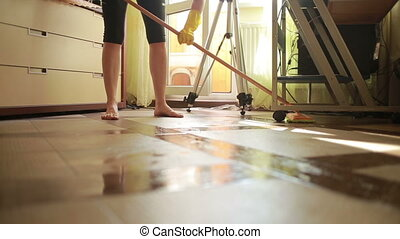 Woman makes cleaning. girl cleaning the floor mop. cleaning...