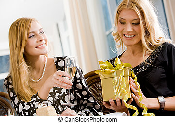 Present - Portrait of pretty woman holding her present with...