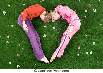 Romantic love - Heart formed by sleeping couple lying on...