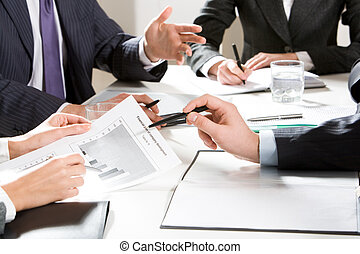 Planning - Close-up of businessman explaining a financial...