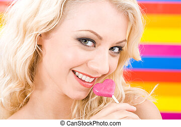 Sweet lady - Image of pretty blonde with lollypop by her...