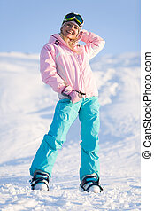 Winter sport - Photo of cheerful young female in sporty...