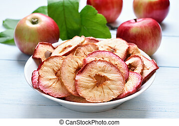 Dehydrated apples chips in bowl, fruit healthy snack