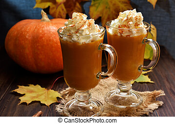 Pumpkin spice latte with whipped cream in glasses, autumn...