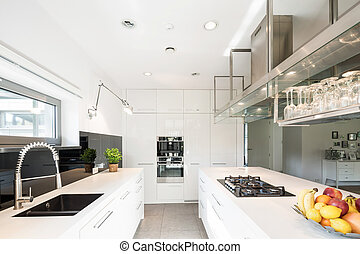 Spacious kitchen in modern style - White high-gloss kitchen...