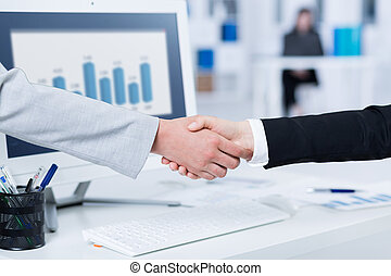 Successful conclusion of business talks - Handshake in...