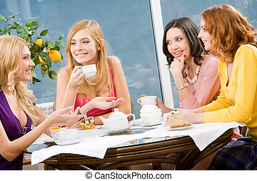 Friendship - Portrait of four attractive women having lunch...