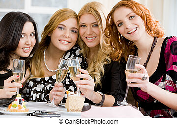 Girlfriends - Portrait of four girlfriends holding beverages...