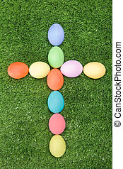 Cross - Image of cross made of easter eggs on green grass