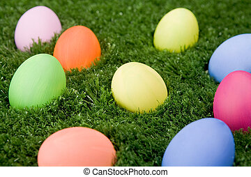 On the lawn - Close-up of coloured easter eggs lying on the...