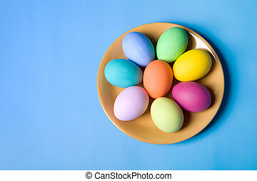 Easter eggs - Photo of easter eggs lying on the saucer on a...