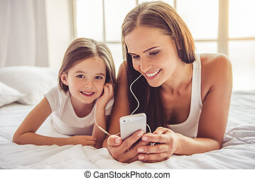Mother and daughter with gadget
