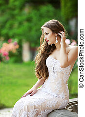 Wedding Portrait Of Beautiful smiling Bride with long wavy...