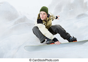 Snowboarding - Portrait of young man going in for...