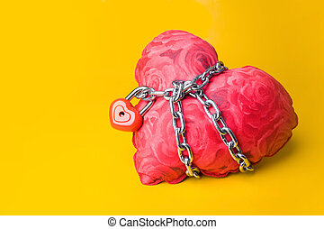 Slave of love - Creative image of soft toy heart bound with...