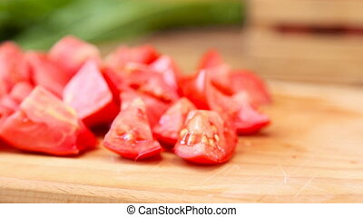 slices of ripe tomato on a wooden table