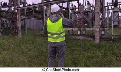 Electricians in electrical substation