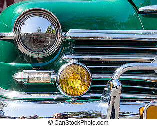 Part of a green old car with headlamp - Close-up photo of...