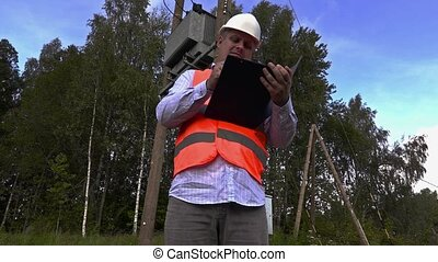 Electrician take transformer technical inspection