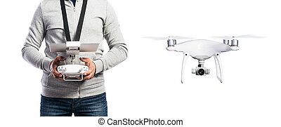 Unrecognizable man with flying drone. Studio shot, isolated....