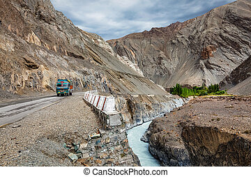Indian lorry trucks on highway in Himalayas. Ladakh, India -...