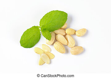 whole blanched almonds - handful of skinless almonds on...