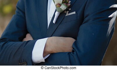 Details of wedding male dress - Man folded his arms then put...