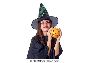 Woman in costume of witch holding a pumpkin