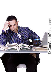 Stressed Businessman at His Desk Working - Isolated Stressed...