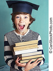 boy with book pile close up photo - preteen handsome boy in...