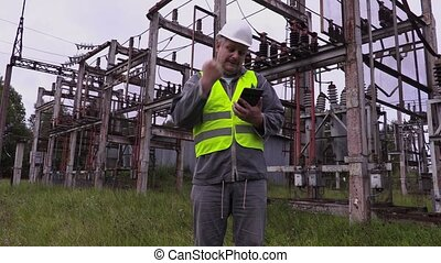 Happy electrician engineer show thumb up at substation