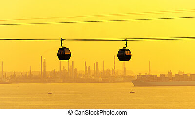 Cable cars transportation to sentosa island with singapore port in backgrounds