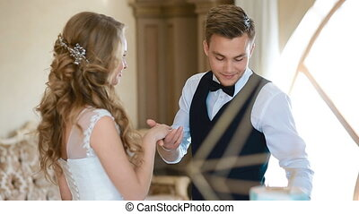 Exchange wedding rings - Two white people groom and bride...