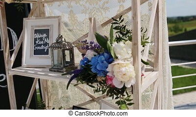 Wedding decoration of the photo zone with flowers and frame