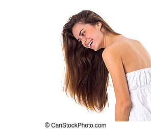 Smiling woman in white dress with long hair