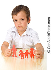 Divorce concept with sad kid holding splitted paper people...