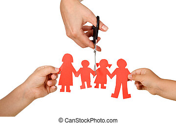 Divorce effect on kids concept with hands cutting paper...