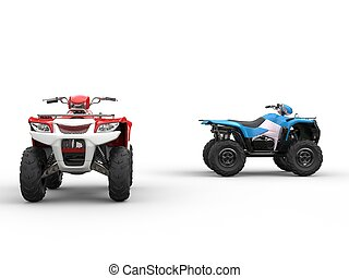 Red and blue all terrain vehicles