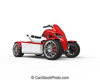 Modern red electric quad bike - studio shot