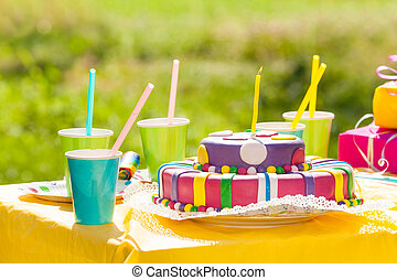 Serving festive table with birthday cake