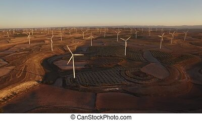Very large wind turbines array at sunset - Modern Wind...