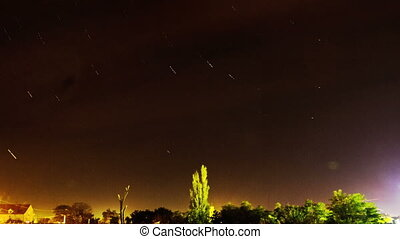 Star Trails over the Small Town - Star Trails Galaxy Spins...