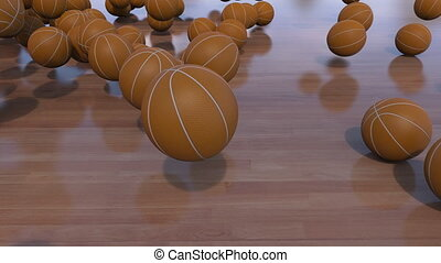 Multiple basketball balls rolling and bouncing on wooden floor. 4K ProRes clip