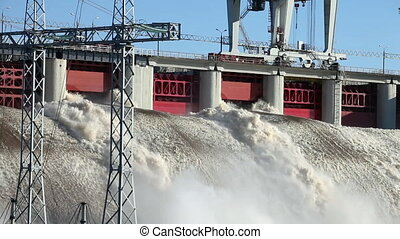 Hydroelectric power station - Spring flood water flowing on...