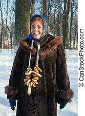 girl in russian traditional clothes against winter rural...