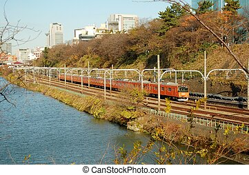 Train by Lake in Tokyo - Train passing by at the lake in...
