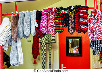 Ornamental woolen mittens hanging at the Riga Christmas market stand