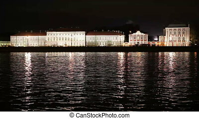 Night view of the University embankment of St. Petersburg through the Neva River- Peter and Paul fortress, Palace bridge, Vasilievsky island.