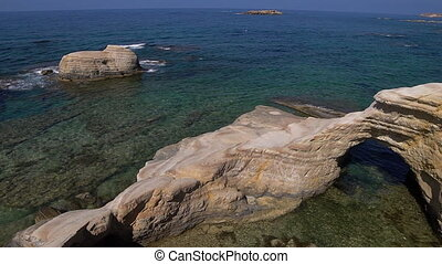 White beach. Mediterranean Sea. Sea landscape of Cyprus with a rocky shore.