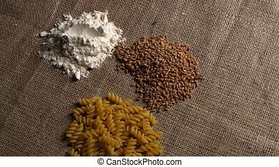 Handful of flour and wheat pasta. Close up. Rotating - Flour...